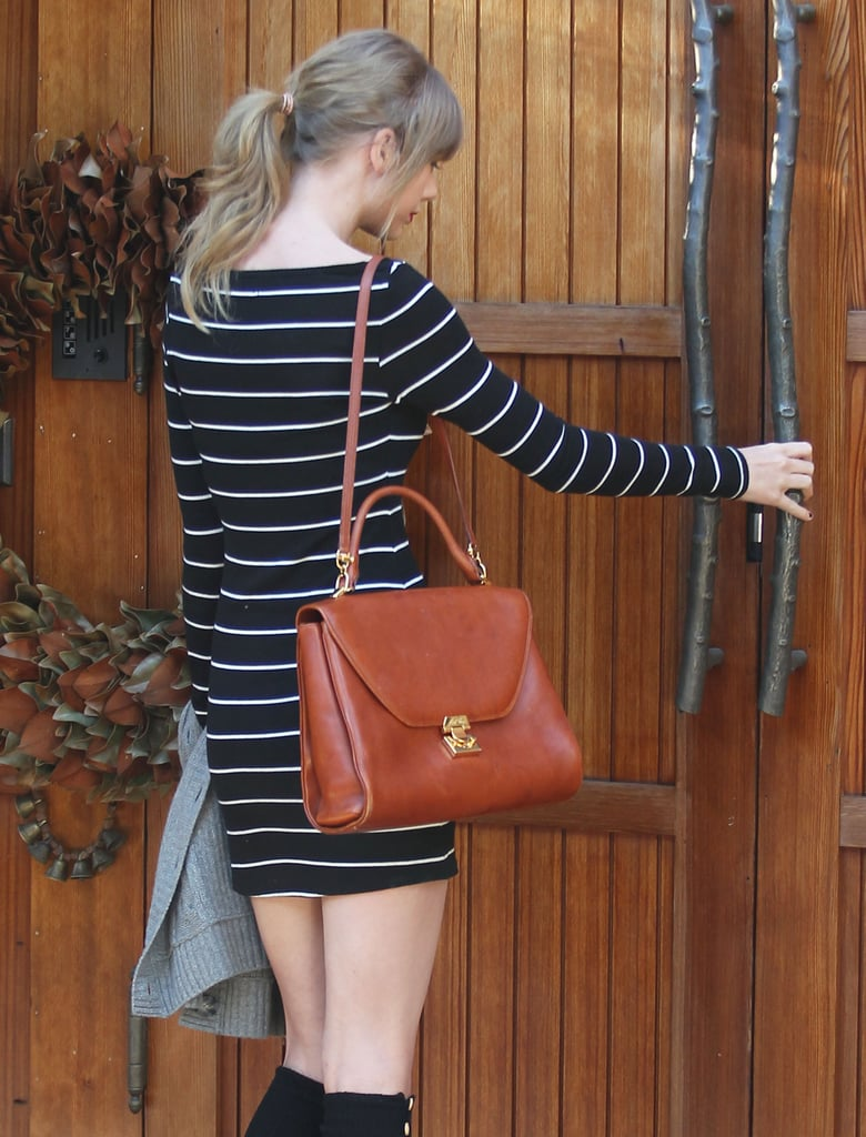 Taylor Swift wore a striped dress.