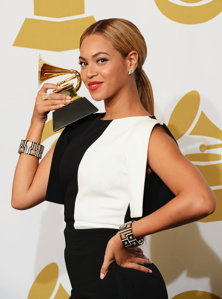 Beyoncé Knowles posed with her Grammy in the press room.