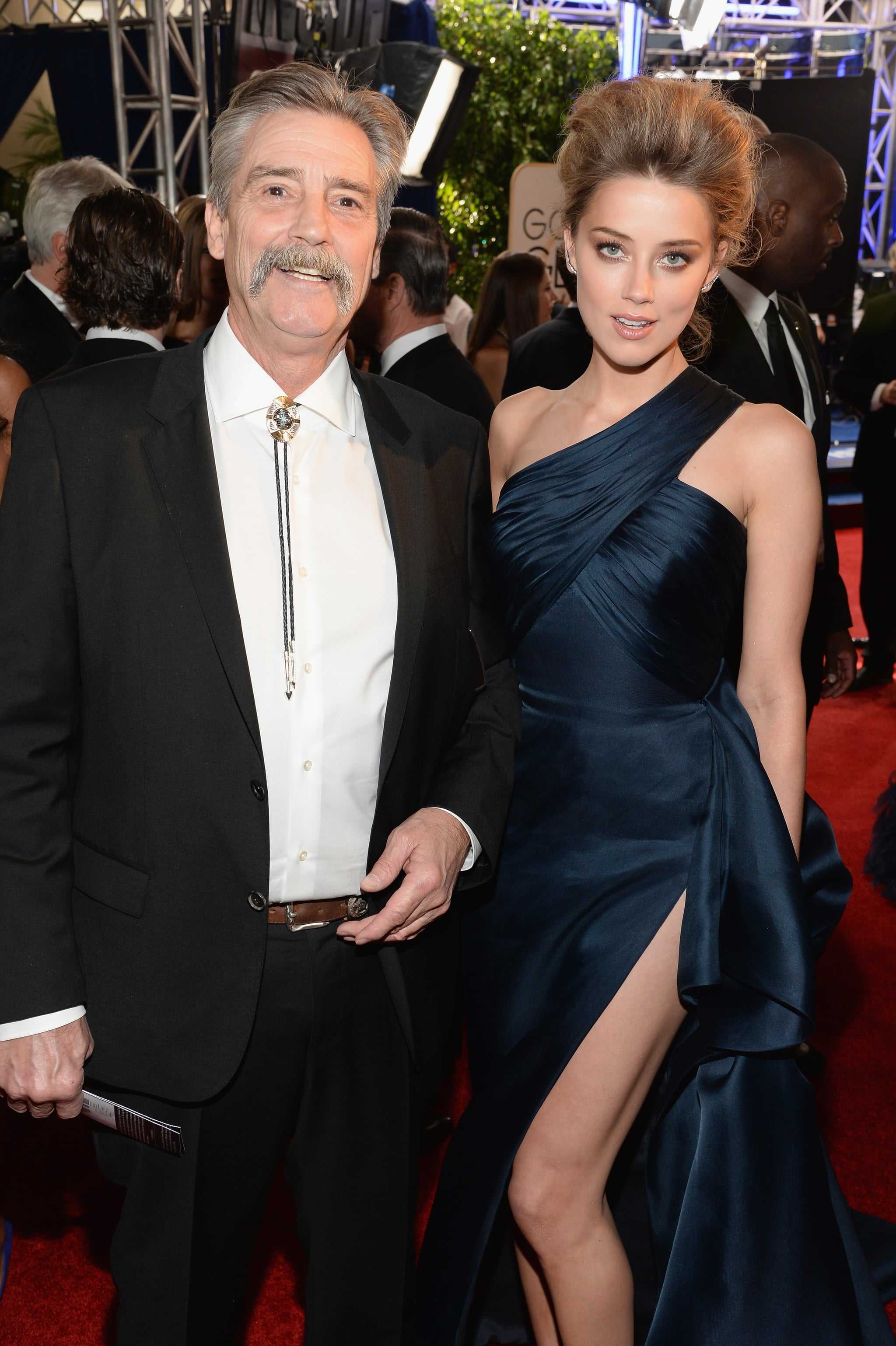 Amber Heard posed with her dad, David, on the red carpet at the Globes.