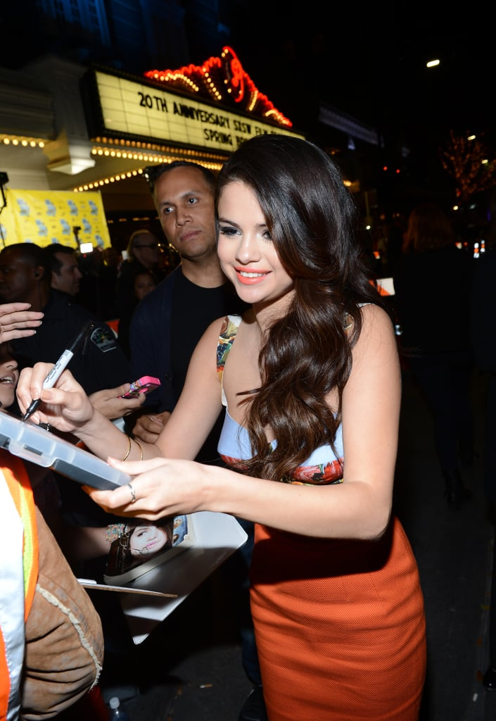 Selena Gomez signed autographs outside the premiere.