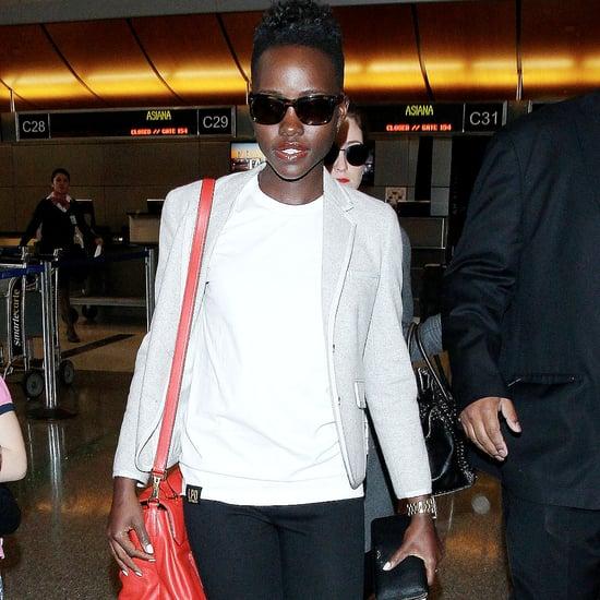 Lupita Nyong'o at Airport With Red Miu Miu Bag