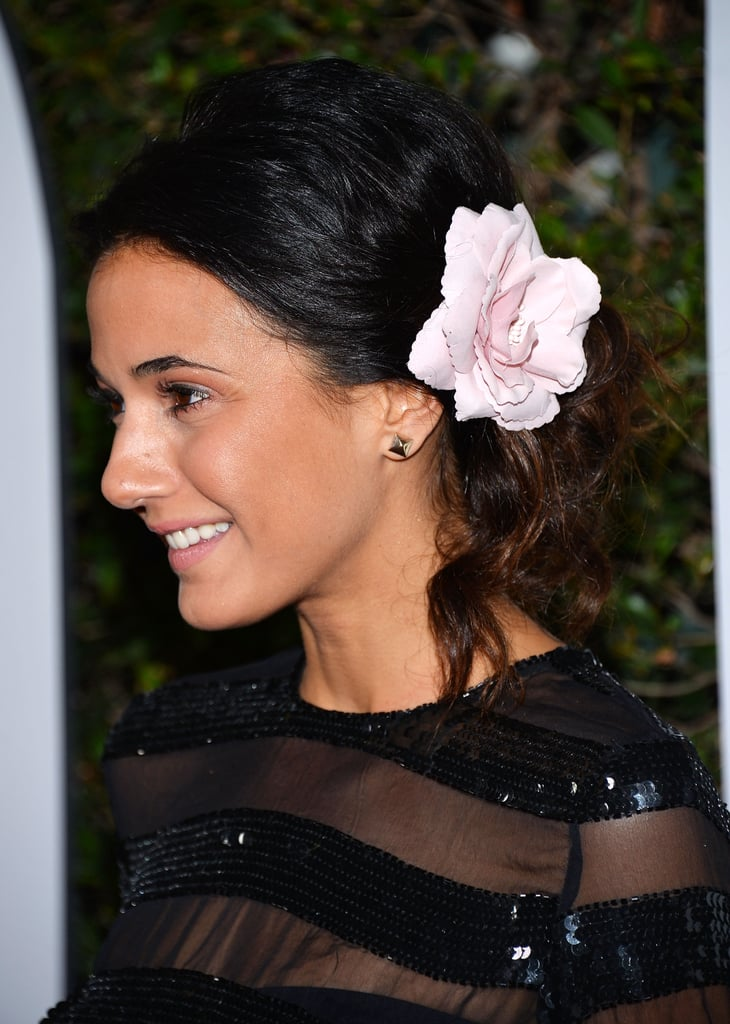 Emmanuelle Chriqui gave us a lesson in how to wear hair flowers when she paired this pink bloom with a loose bun at the Mandela: Long Walk to Freedom premiere.