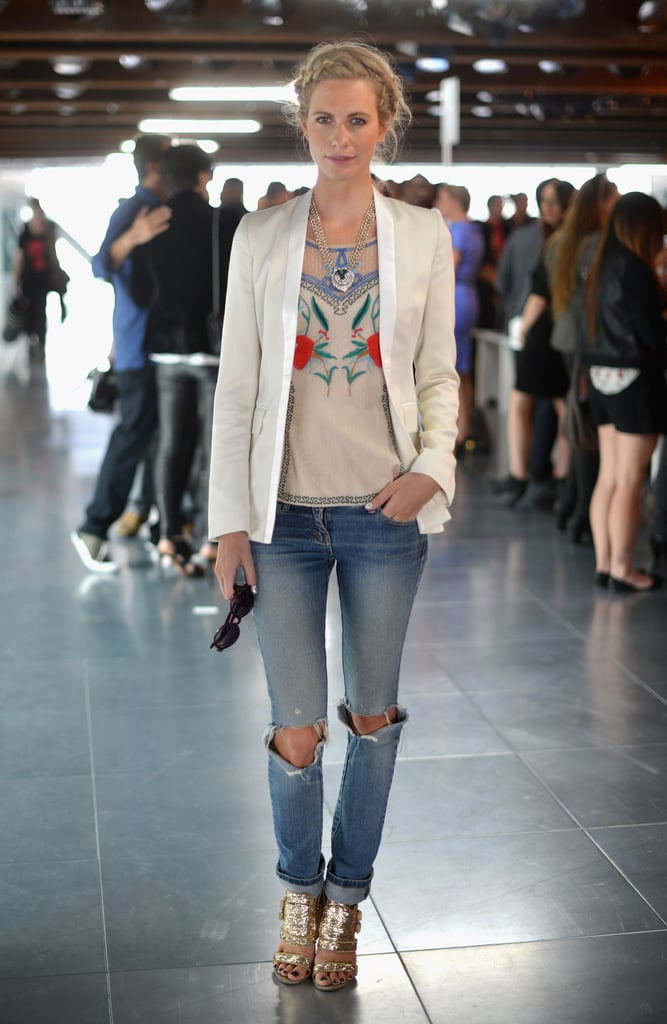 For her friend Matthew Williamson's Spring '13 runway show, Poppy went boho-casual in Sass & Bide jeans, an Alice Temperley blouse, and a crisp white Zoe Jordan blazer. She finished the look with gold Givenchy cage heels and a playful braided hairdo.