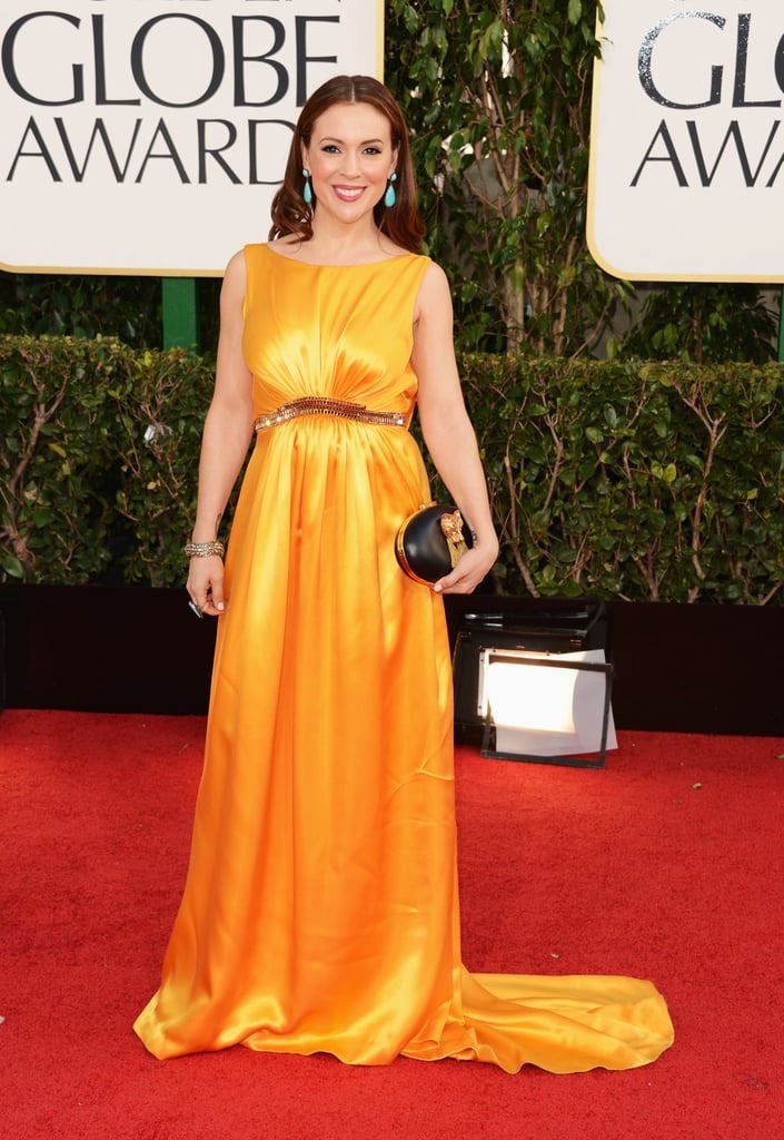 Alyssa Milano —mom to lil Milo, 1 — brightened up the red carpet in a long yellow gown.