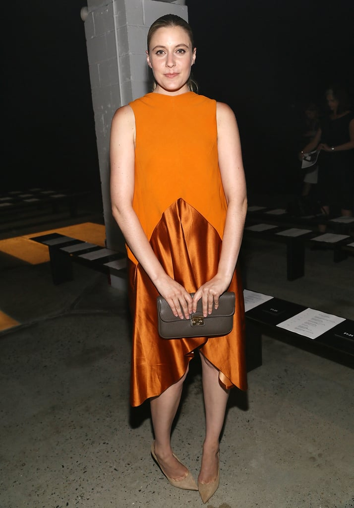 Greta Gerwig's burnt orange ensemble popped at the Narciso Rodriguez show.