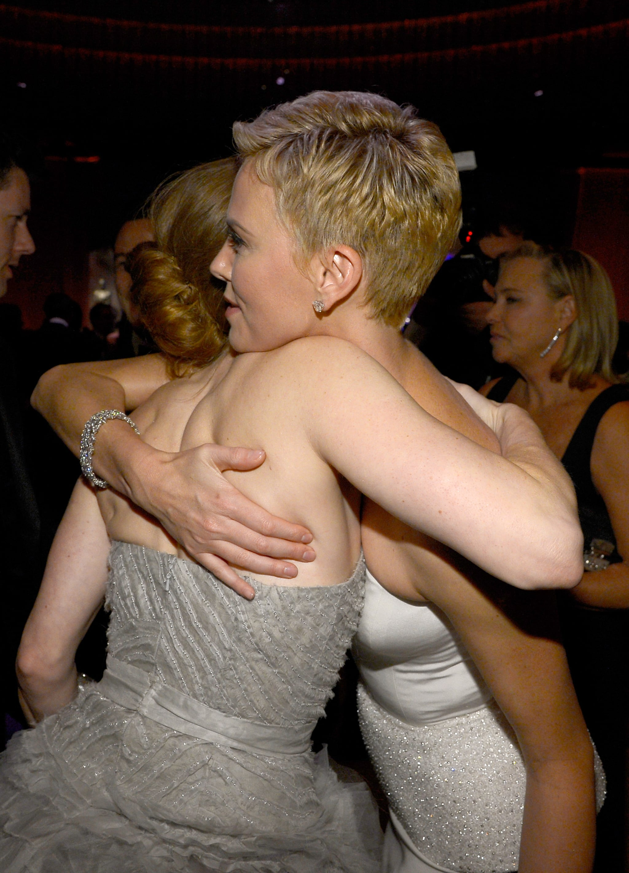 Amy Adams and Charlize Theron hugged at the Governors Ball.