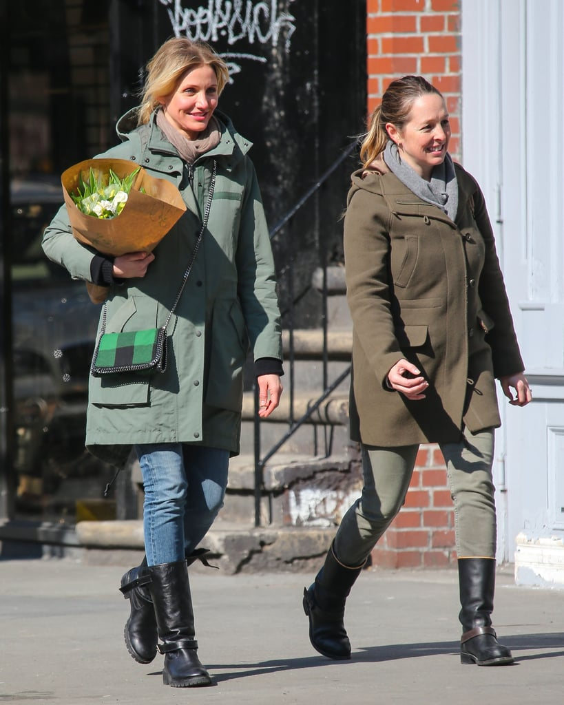 Cameron Diaz carried flowers for a stroll with a friend in NYC.