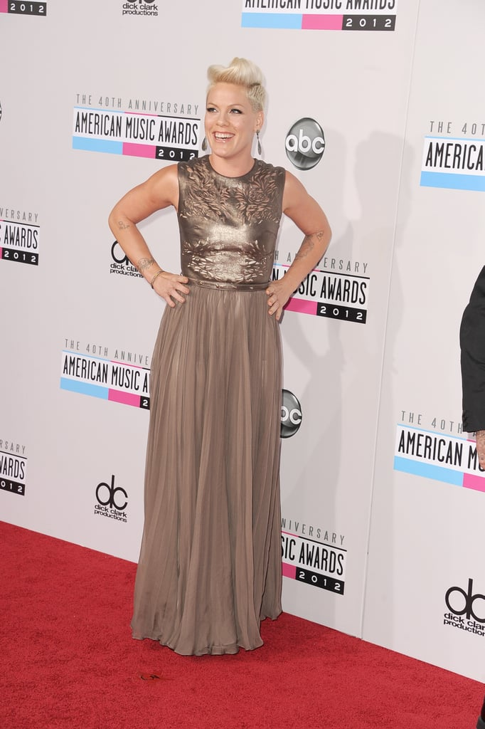 Pink had her hands on her hips on the red carpet.