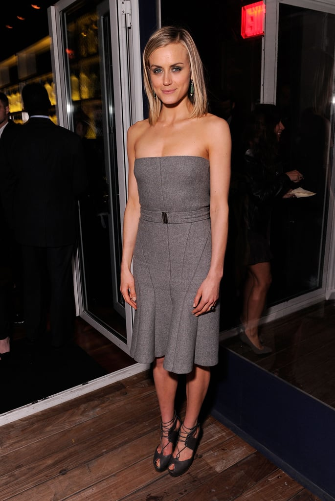 Taylor Schilling posed at the Cinema Society and Men's Health screening of The Lucky One in NYC.