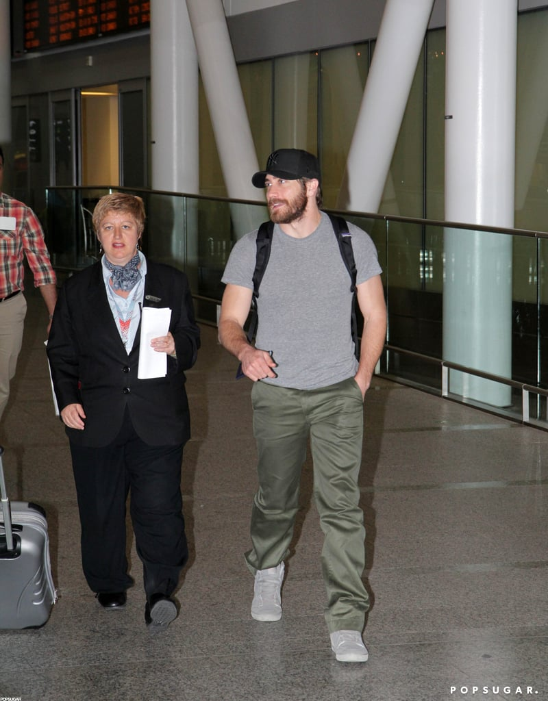 Jake Gyllenhaal arrived at the Toronto airport wearing a gray t-shirt and pants.