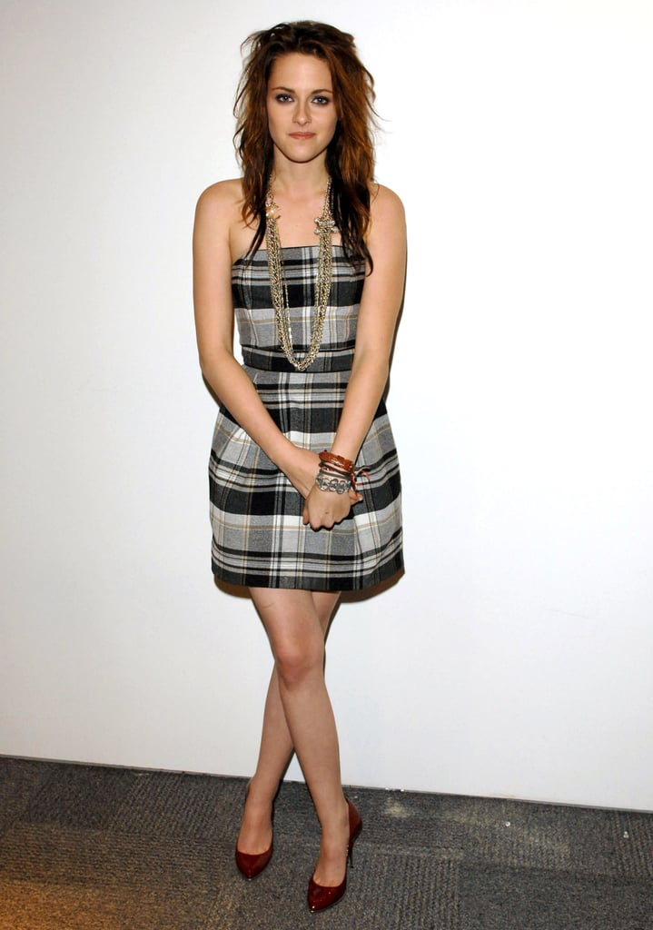 Stewart proved preppy in a plaid French Connection minidress and multichain Chanel necklace in Toronto in 2008.