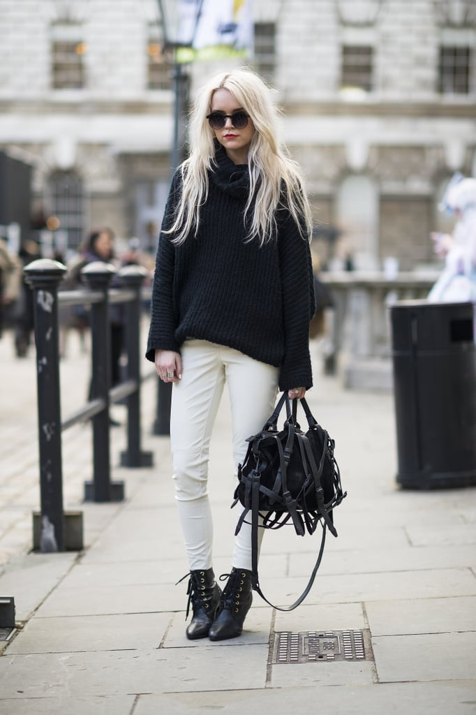 The texture on her oversize knit and buckles on her bag made this white and black contrast all the more striking. Source: Le 21ème | Adam Katz Sinding