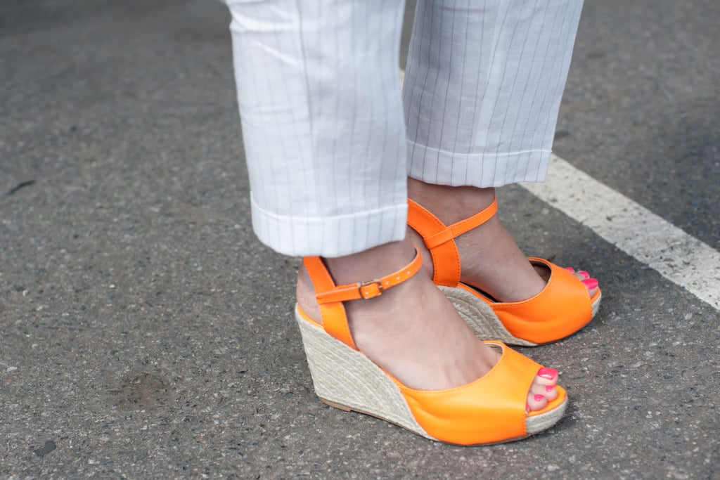 Espadrilles in a bold, tangerine hue juxtaposed a pair of classic trousers.