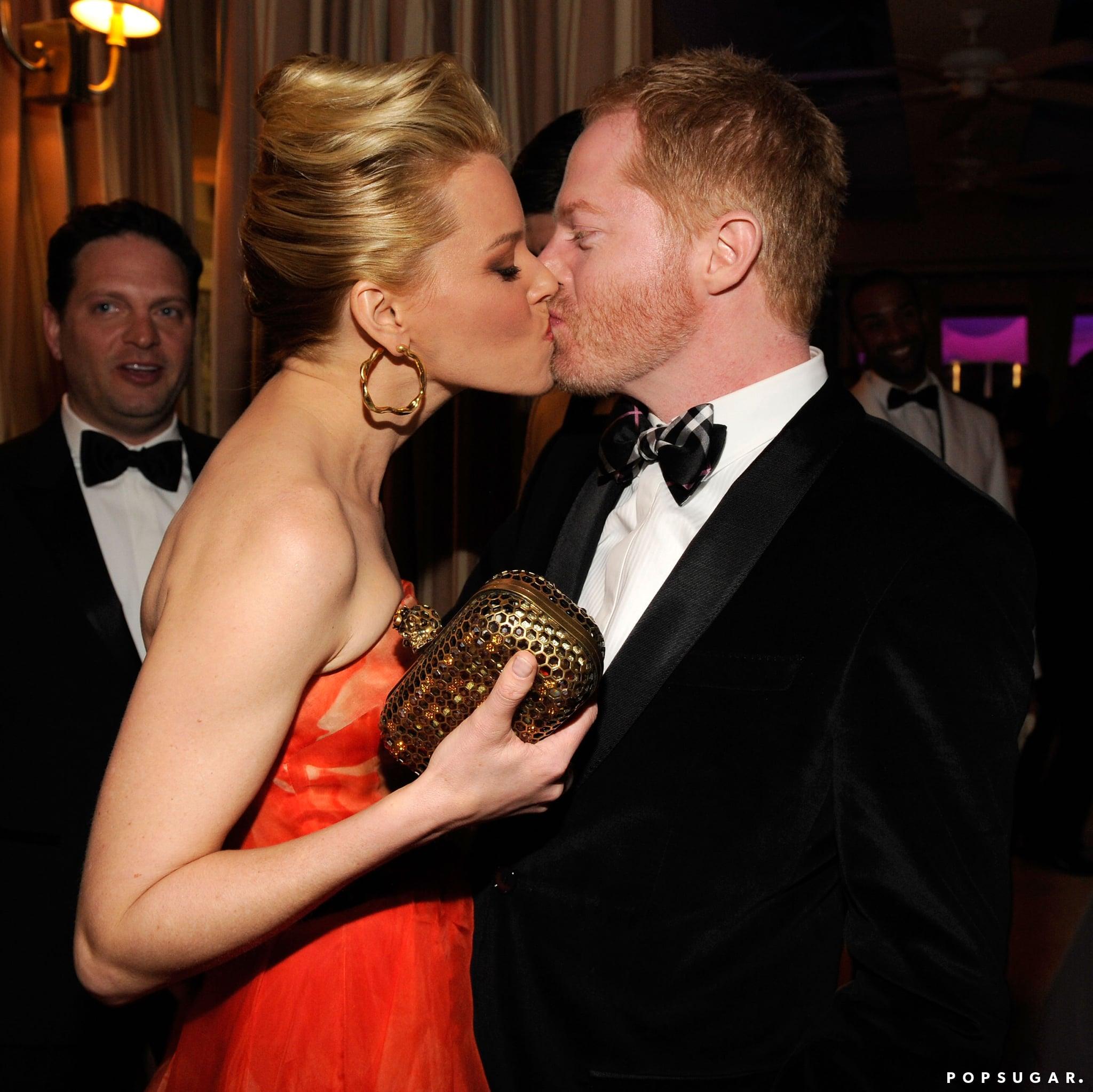Elizabeth Banks and Jesse Tyler Ferguson locked lips inside the Vanity Fair Oscar party on Sunday in Hollywood.