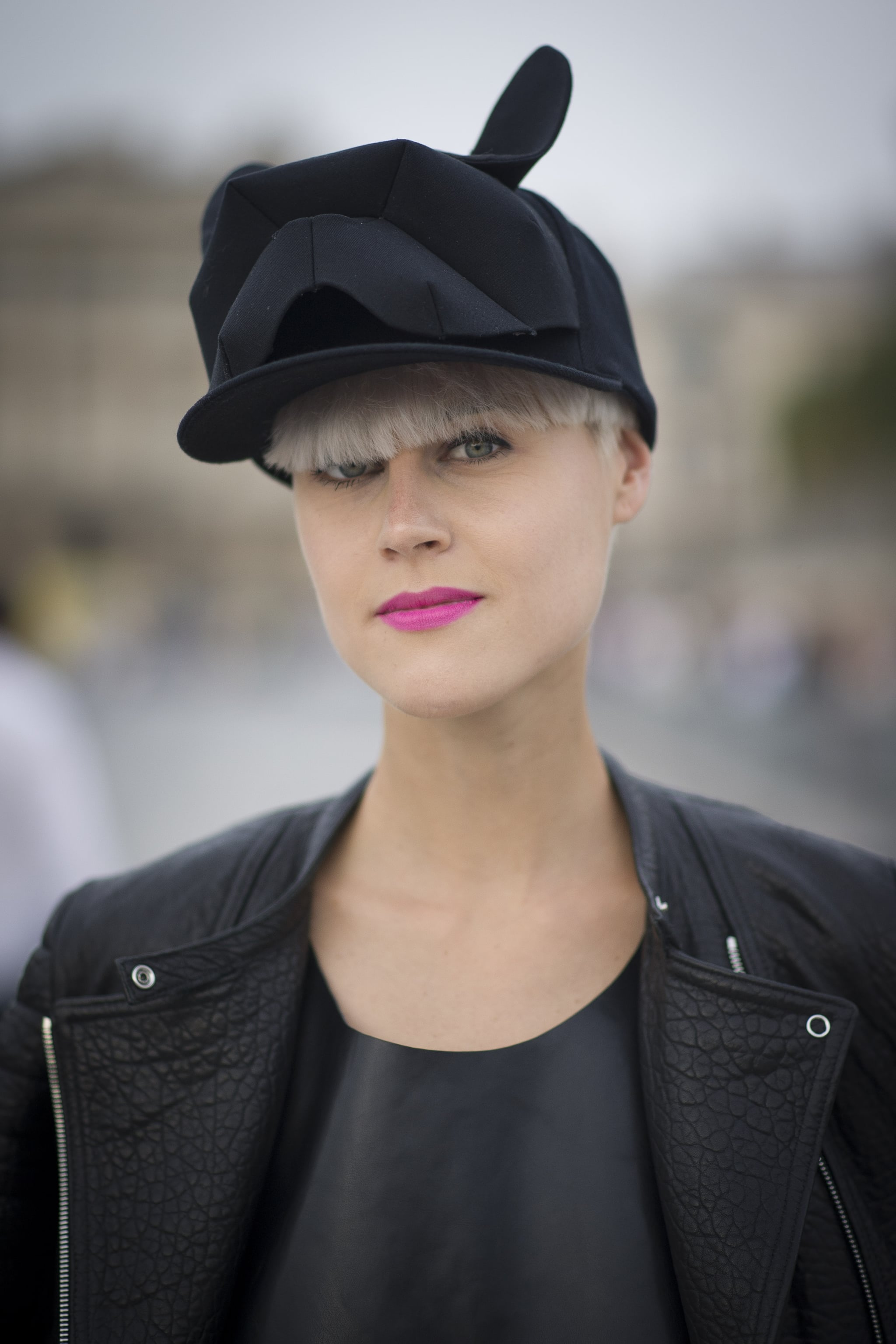 Bangs and a pixie look super edgy when paired with an oversized cap.