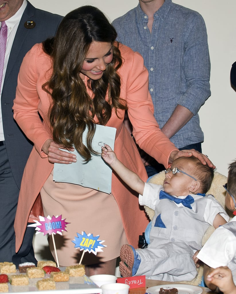Kate shared a precious moment with a little boy while visiting England's Naomi House Children's Hospice in April.