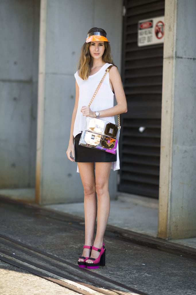 This showgoer punched up simple separates with high-impact add-ons. Source: Le 21ème | Adam Katz Sinding