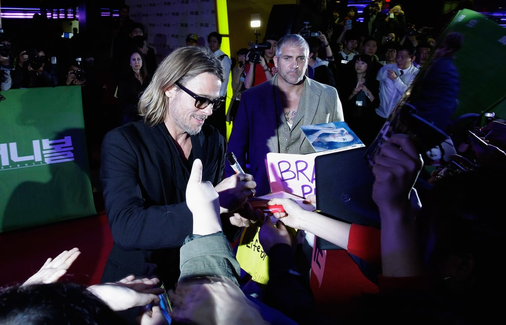 Brad Pitt stopped to sign autographs for his Korean fans.