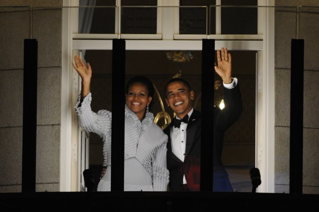 Barack and Michelle Obama waved from a window at Oslo's Grand Hotel in December 2010 after President Obama accepted the Nobel Peace Prize.