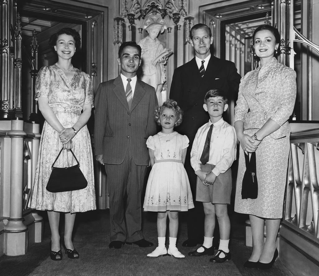 The royal family posed with King Hussein of Jordan and his wife Queen Dina during their honeymoon in England in 1955.