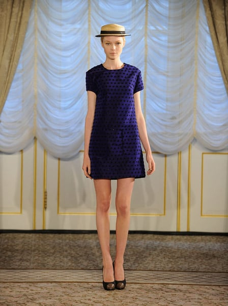 Mod and polka dots unite for this demure yet cheeky frock. Cool hat, too!