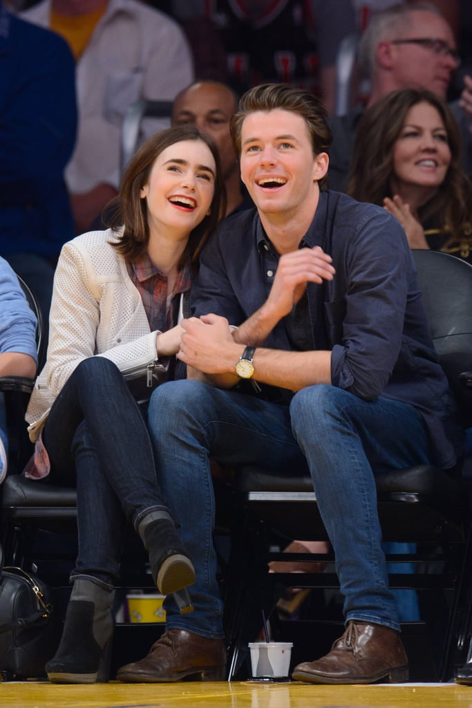Lily Collins skipped team colors in favor of a perforated leather jacket at a February game.