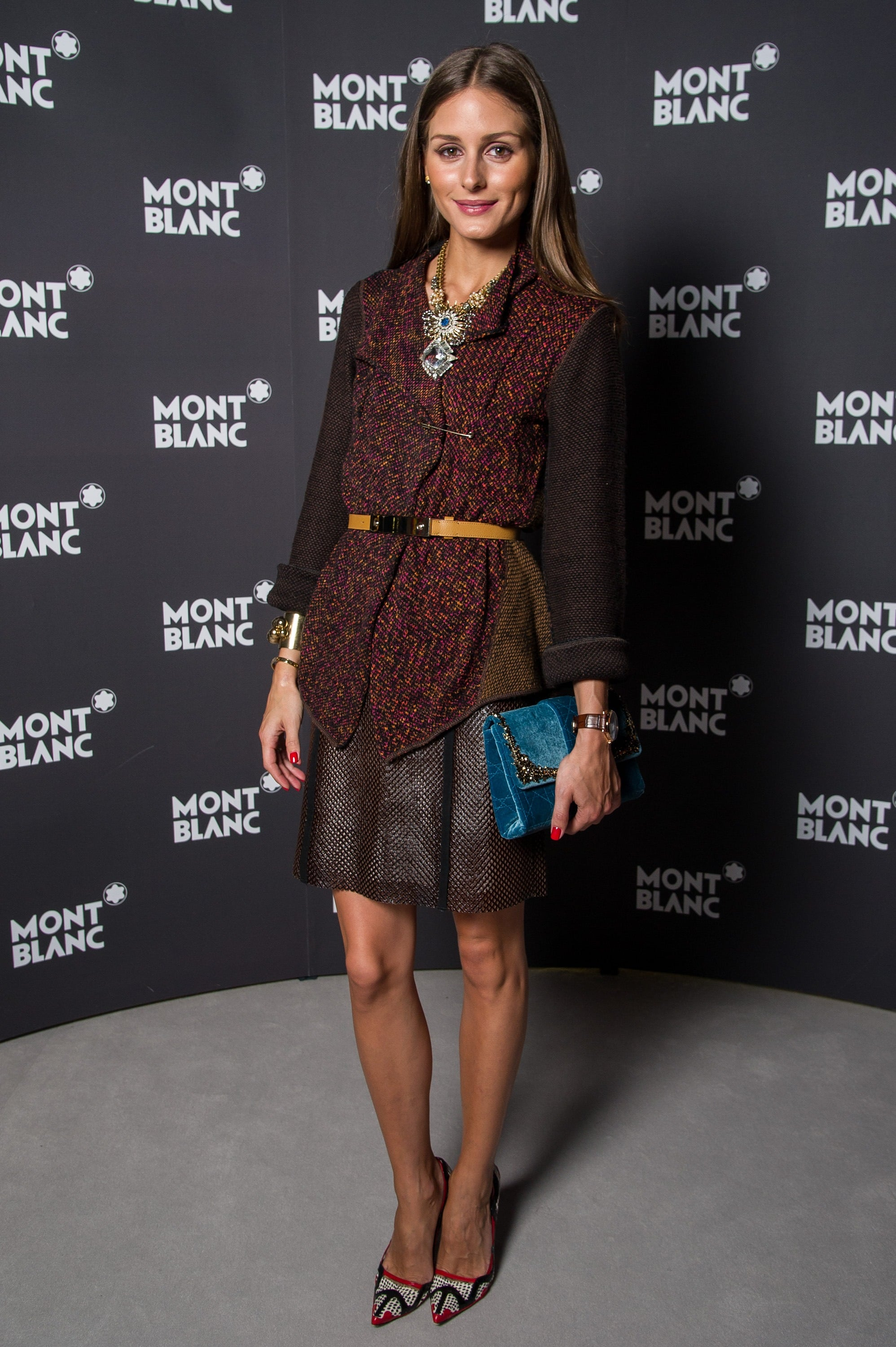 Olivia stopped by a Montblanc event in an eclectic-meets-sophisticated play on a tweed jacket, statement jewels, and playful pumps.