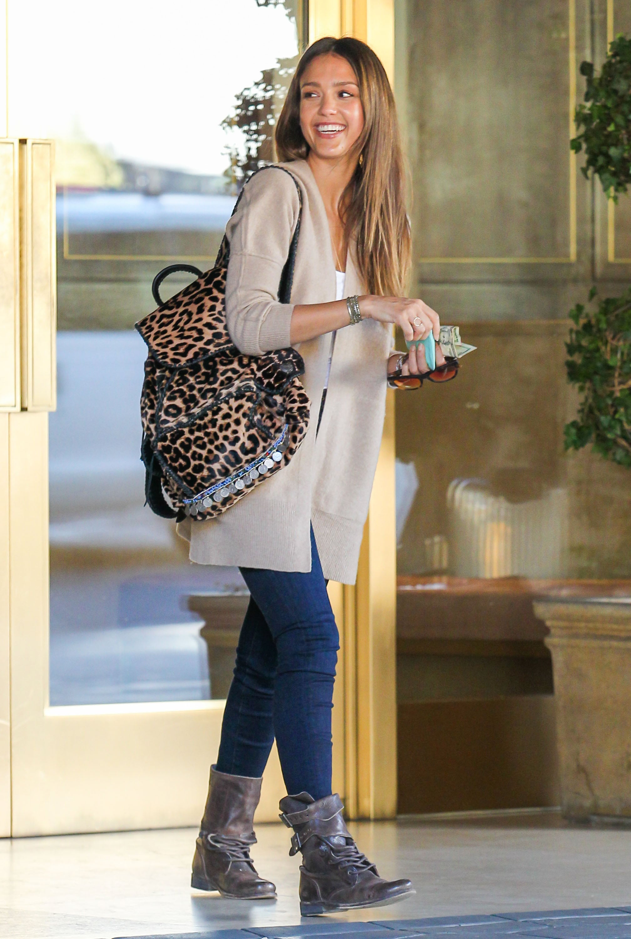 Jessica Alba in Cashmere Inhabit Cardigan and Leopard Simone Camille Backpack
