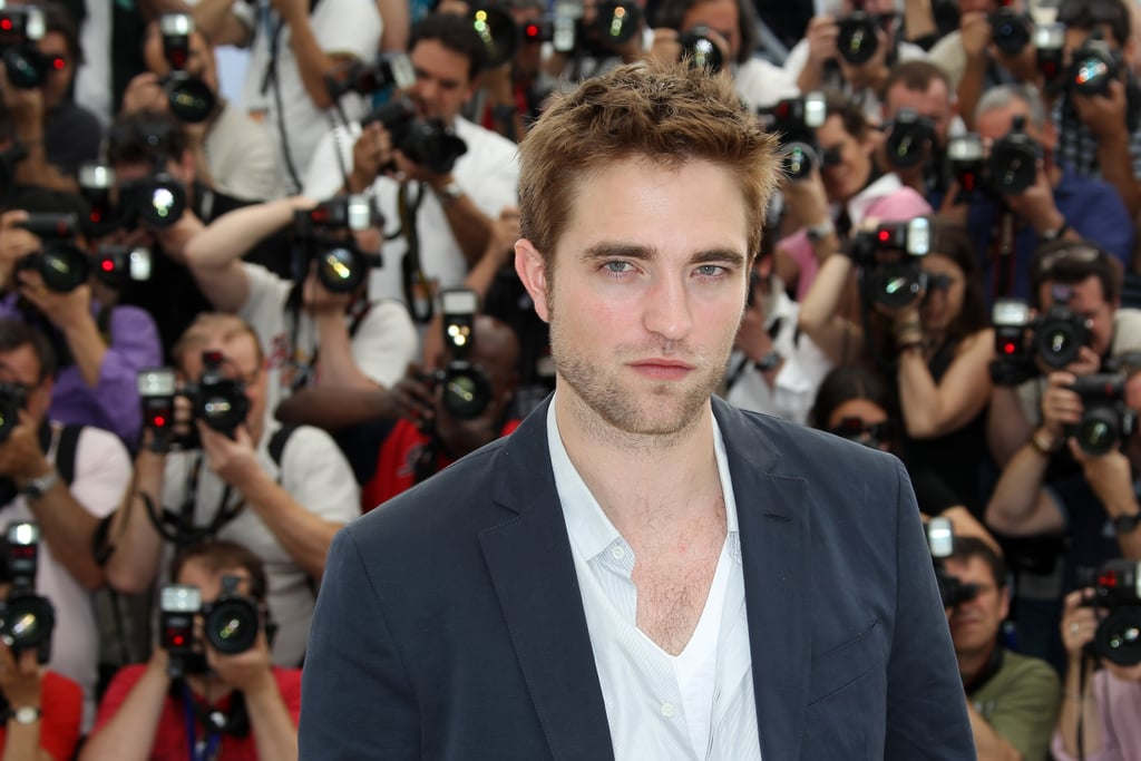 Robert Pattinson gave a sexy glance at the Cosmopolis photocall in Cannes.