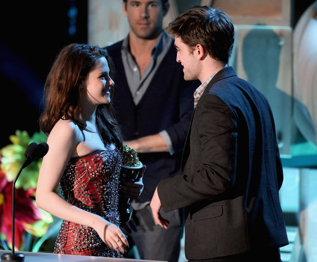 Kristen Stewart rocked a sexy Balmain dress to the 2011 MTV Movie Awards and showed it off while accepting an award with Robert Pattinson.