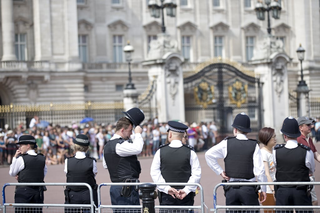 Police officers lined up outside Buckingham Palace as crowds gathered.