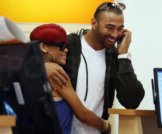 Slide Picture of Rihanna and Matt Kemp Looking at iPhones
