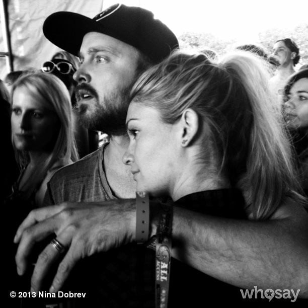 Aaron Paul and his wife, Lauren Parsekian, cuddled during The Lumineers show at Lollapalooza. Source: Nina Dobrev on WhoSay