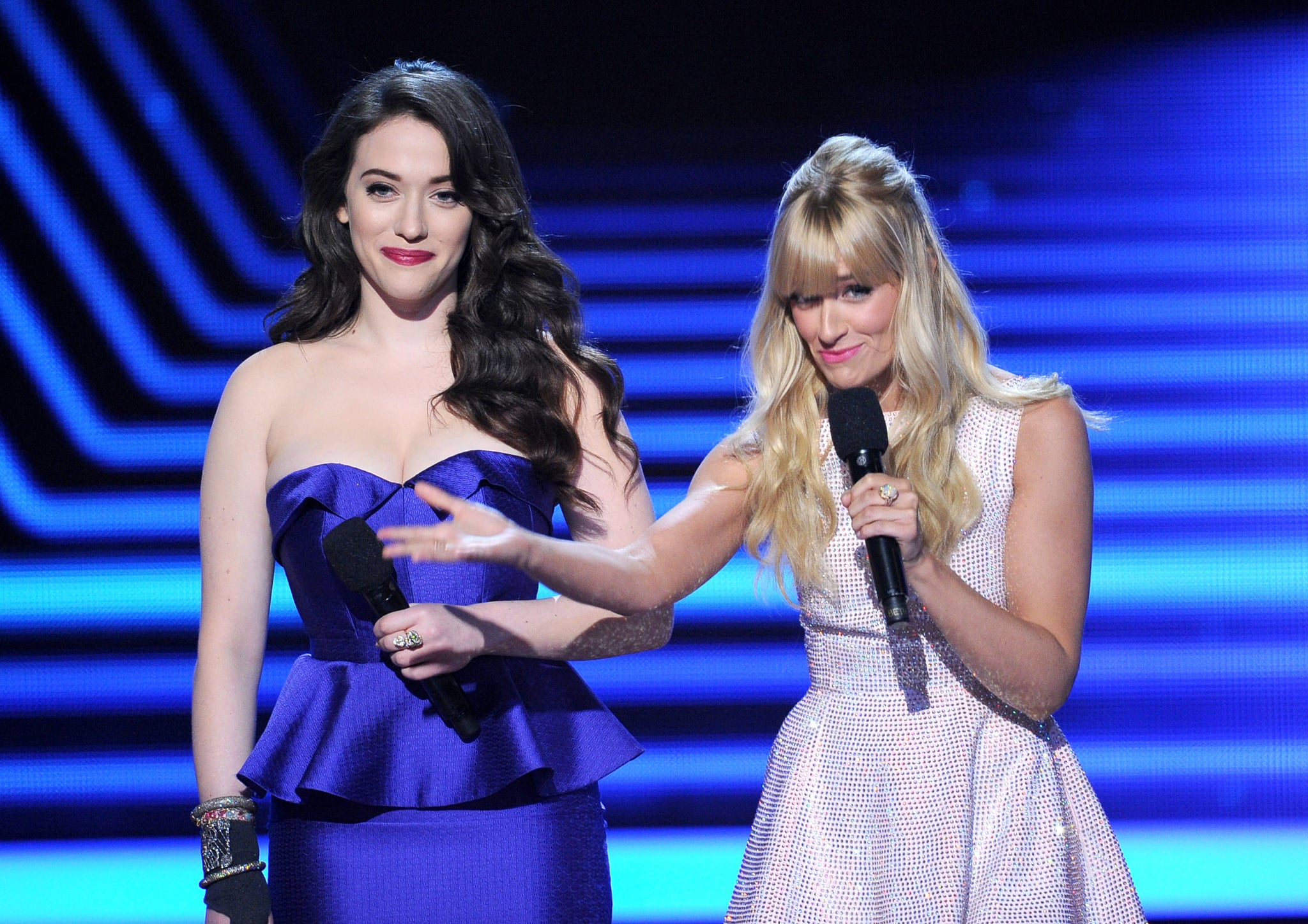 Kat rocked a violet peplum Oliver Tolentino Couture dress while cracking jokes with Beth on stage.
