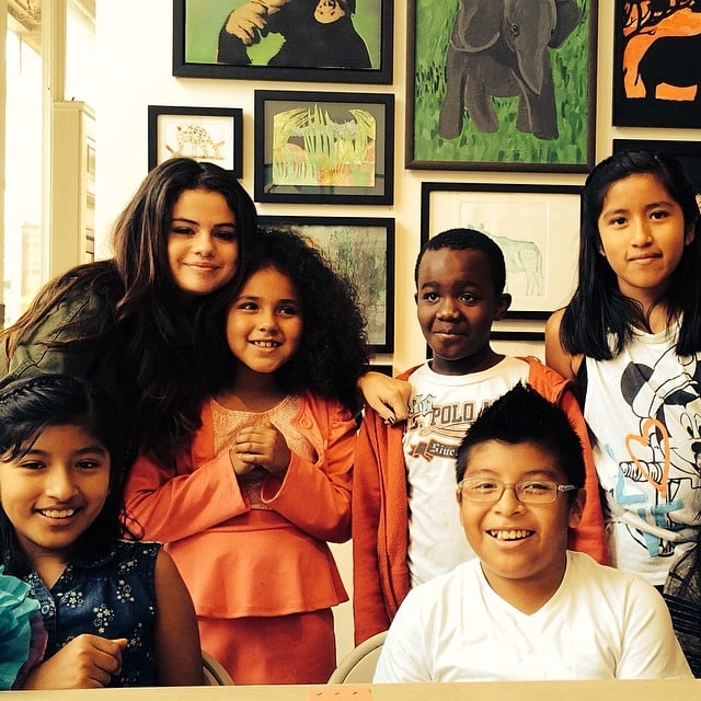 "Selena Gomez took a photo with kids at the Heart of Los Angeles center, which provides the community's youth with programs in academics, arts, and athletics. Selena wrote in the caption, ""You do amazing things for the children of Los Angeles. Thank you for letting me stop by!"" Source: Instagram user selenagomez"