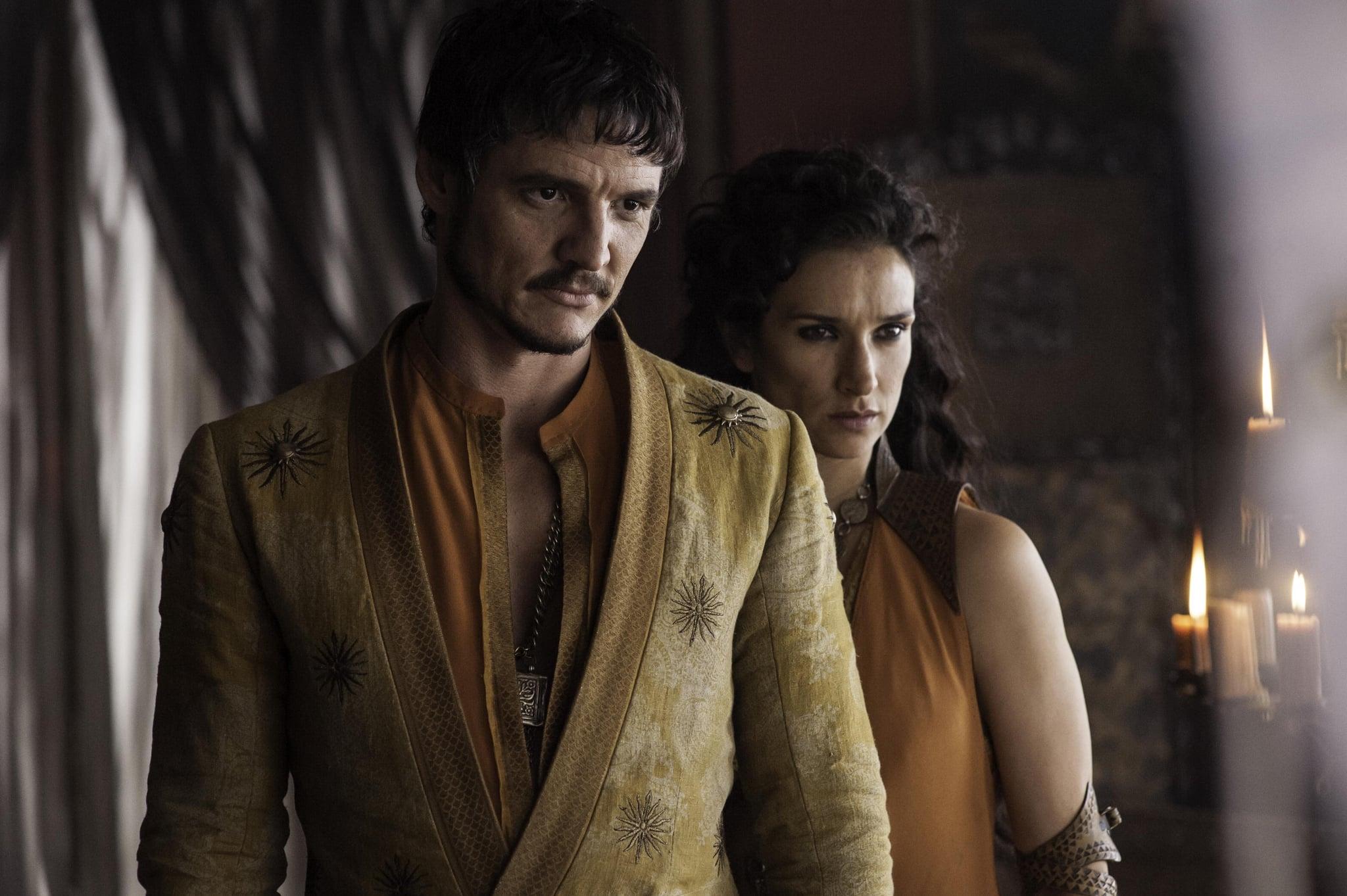 Pedro Pascal as Oberyn Martell and Indira Varma as Ellaria Sand.