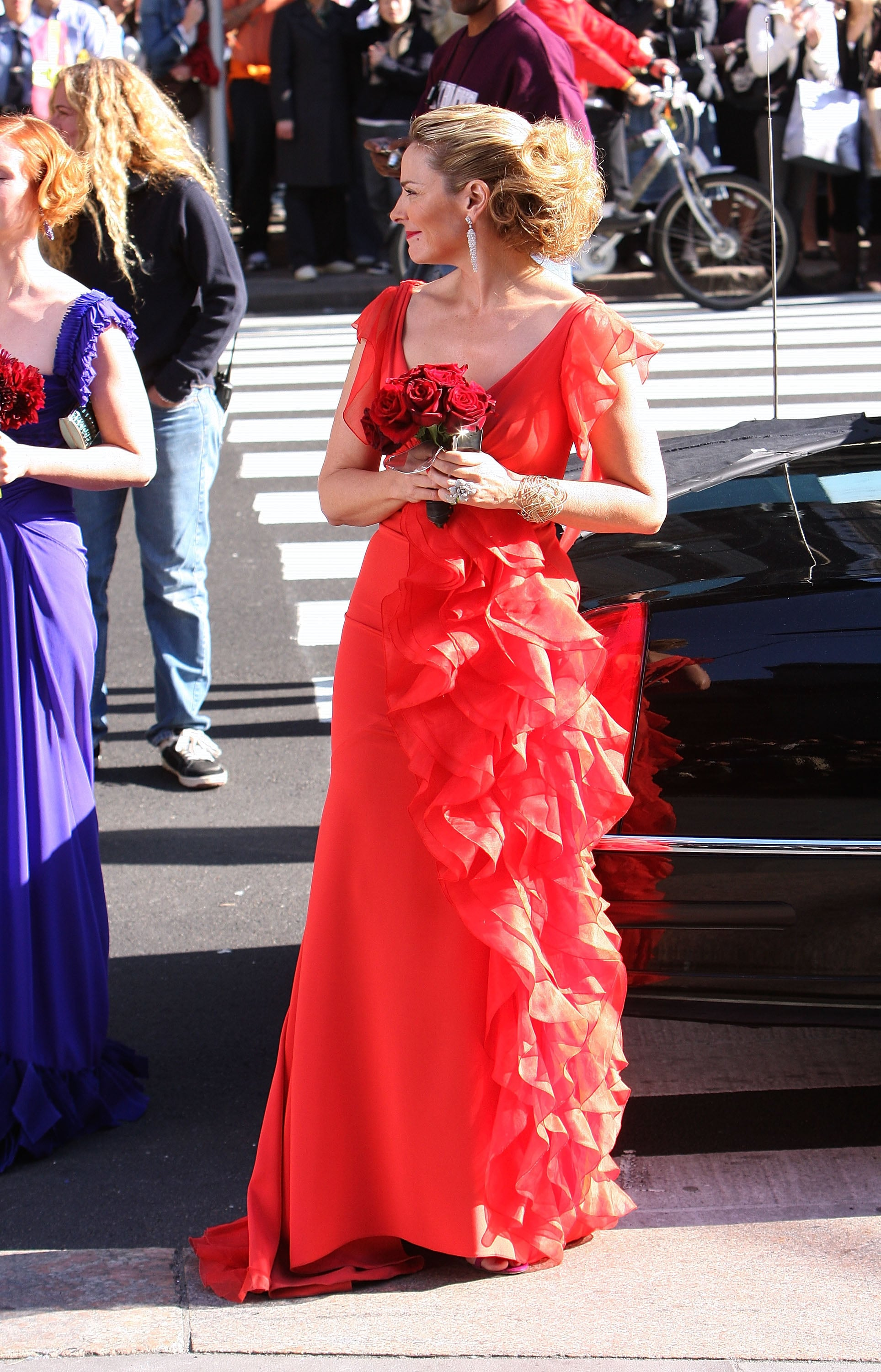 En route to Carrie's disastrous would-be wedding, Samantha is quite the head-turner in a ruffled red confection. Just look at her train!