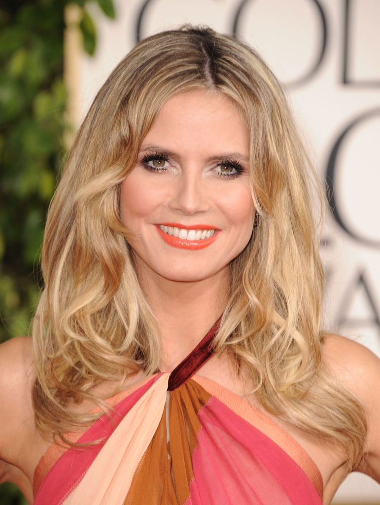 Bright tangerine lipstick was the highlight of her beauty look at the 2011 Golden Globe Awards.