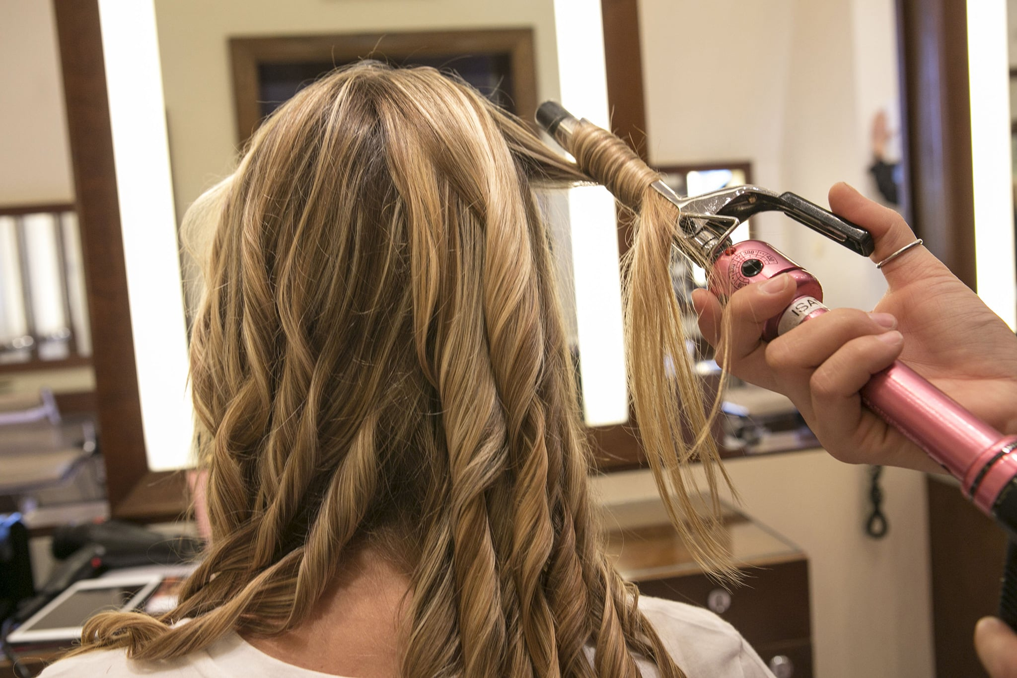 If you already have natural texture, start off with air-dried hair. Otherwise, run a curling iron through your strands to give yourself a textured base.