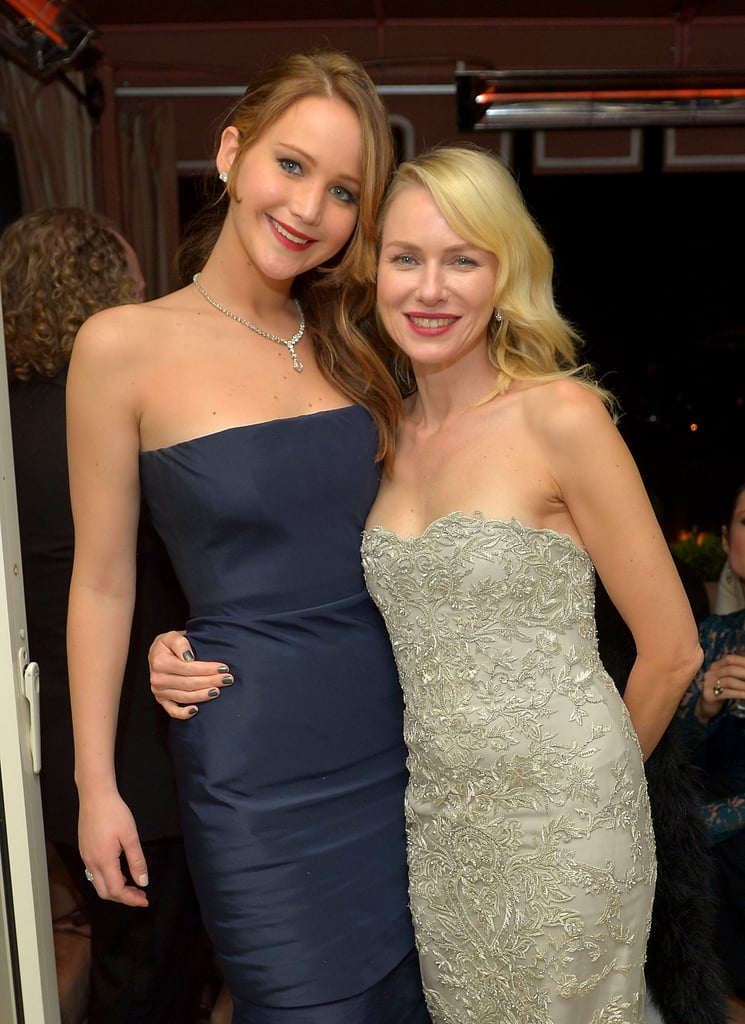 Actresses Jennifer Lawrence and Naomi Watts got cosy at the Weinstein Company after-party on January 28.
