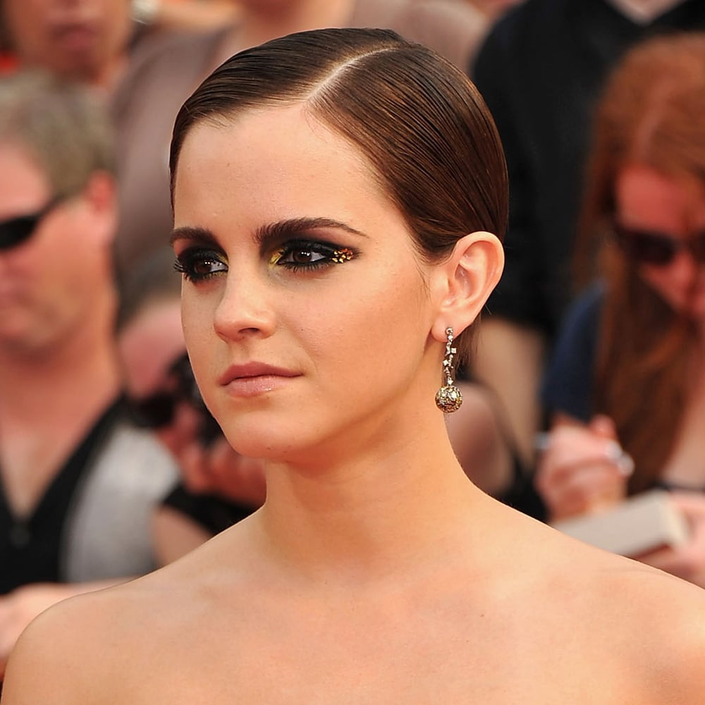 Slicked back and paired with dramatic eyes — Emma went dark and moody, and totally sexy, in July 2011.