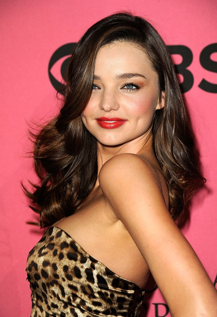 Darker brown hair and red lips were Miranda's look at the Victoria's Secret 2011 Fashion Show Viewing Party.