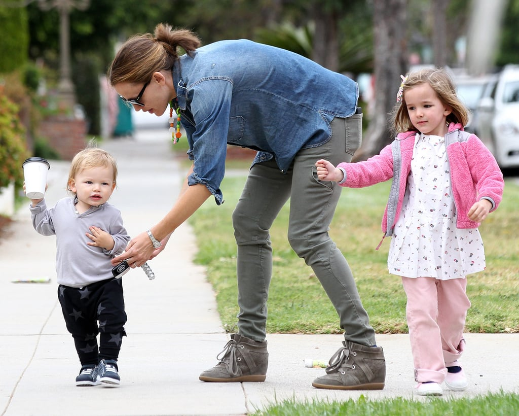 Jennifer Garner took her kids to lunch in Santa Monica on Sunday as Samuel showed off his walking skills and Violet pranced around in pink.