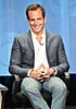 Will Arnett smiled while on stage.