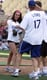 Jessica Lowndes gave a fellow softball player some skin during a June 2009 game in LA.