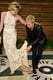 Ellen DeGeneres helped Portia de Rossi with her dress at the Vanity Fair Oscars party.