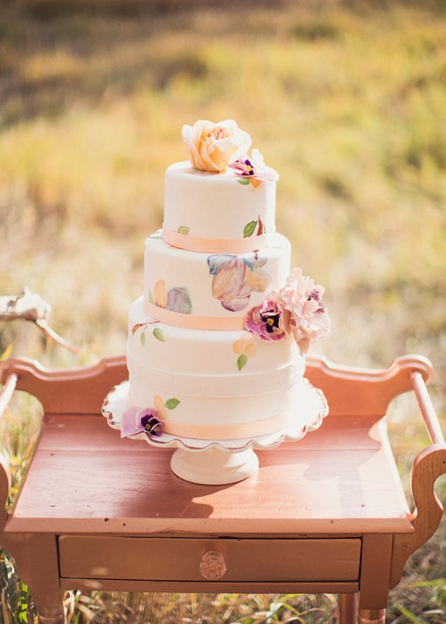 Pastel colors automatically make a cake feel girlie; top that with hand-painted details, and you've got one charming dessert.