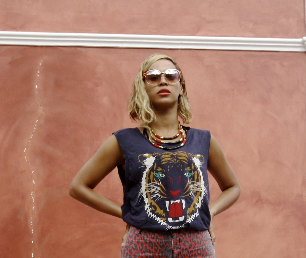 Beyoncé Knowles wore a Lovers & Friends muscle tee during her vacation. Source: Tumblr user Beyoncé Knowles