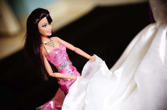 Barbie's bridesmaid adjusts the train. Photo by BdG Photography via Rock n Roll Bride
