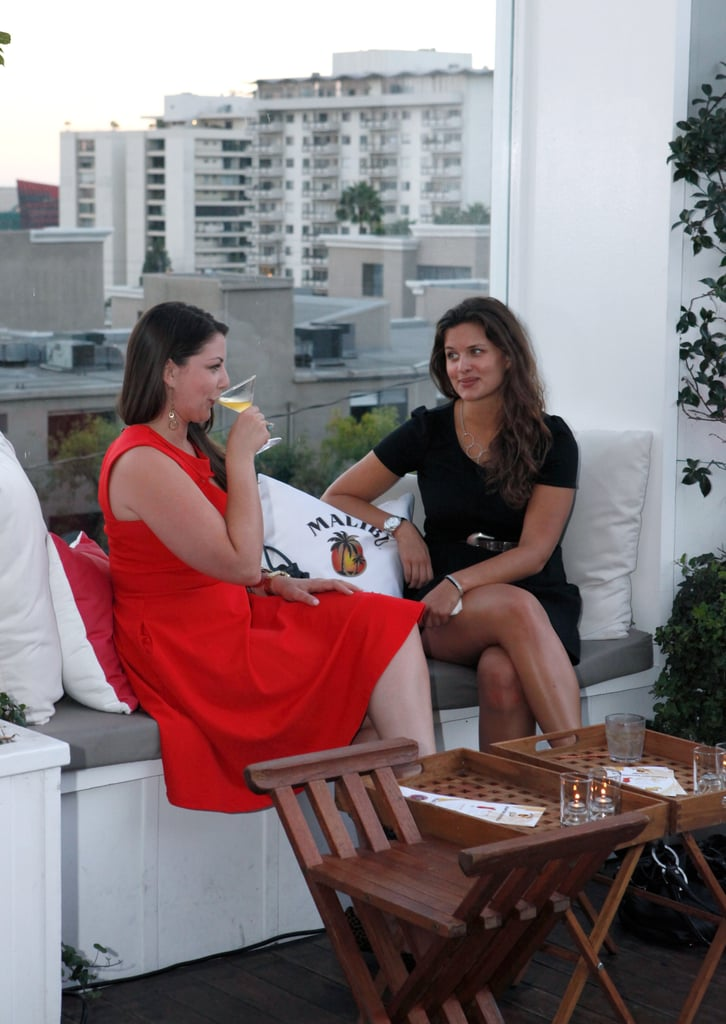 Partygoers sipped drinks at the poolside bash.